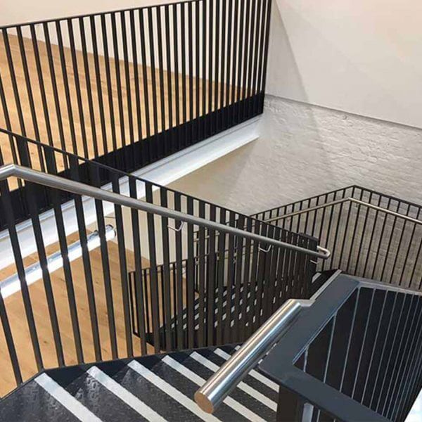 Industrial style staircase situated in a modern London retail unit